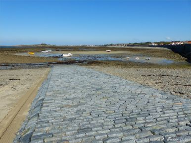 Cobbles of local stone in the slipway at Rocquaine Bay