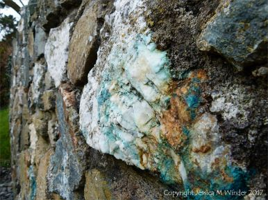 Stone wall with quartz and copper boulder