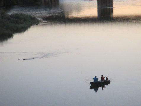boater, fisherman, fishing boat, American River, Fair Oaks, Fair Oaks Bridge, salmon, shadows, sunset, darkness, river, ducks, swimming