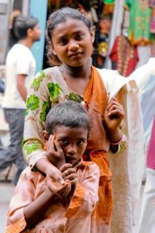 Two children begging