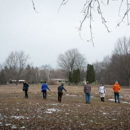 Volunteers help seed 25 acres of what will become prairie on The Highlands.