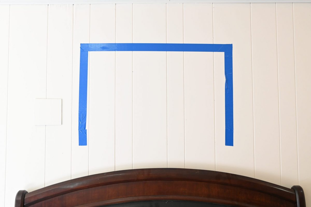 large artwork layout over bed with painters tape