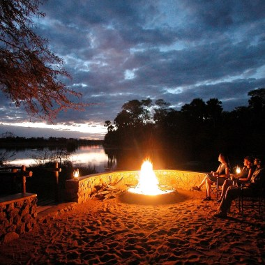 Camp-fire-next-to-the-Shire-river,-Liwonde,-Malawi