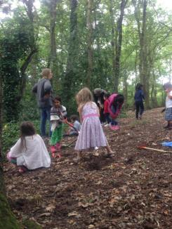 Children digging in woodland