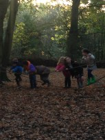 children climding rope wobbly bridge