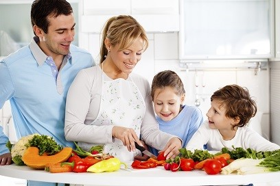 Happy family preparing a healthy dinner at home.