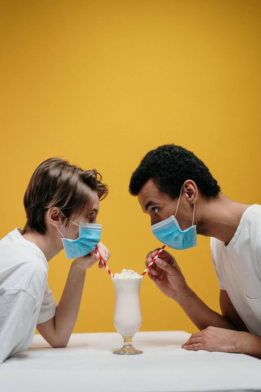 man and woman drinking milkshake