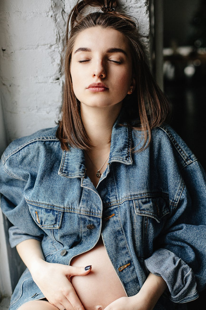 woman in blue denim button up jacket