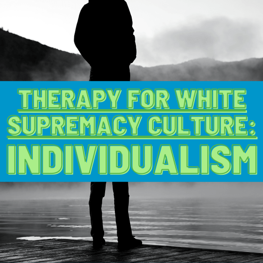 An individual person stands at a shoreline looking at the mountains. Individualism is a core component of white supremacy culture.
