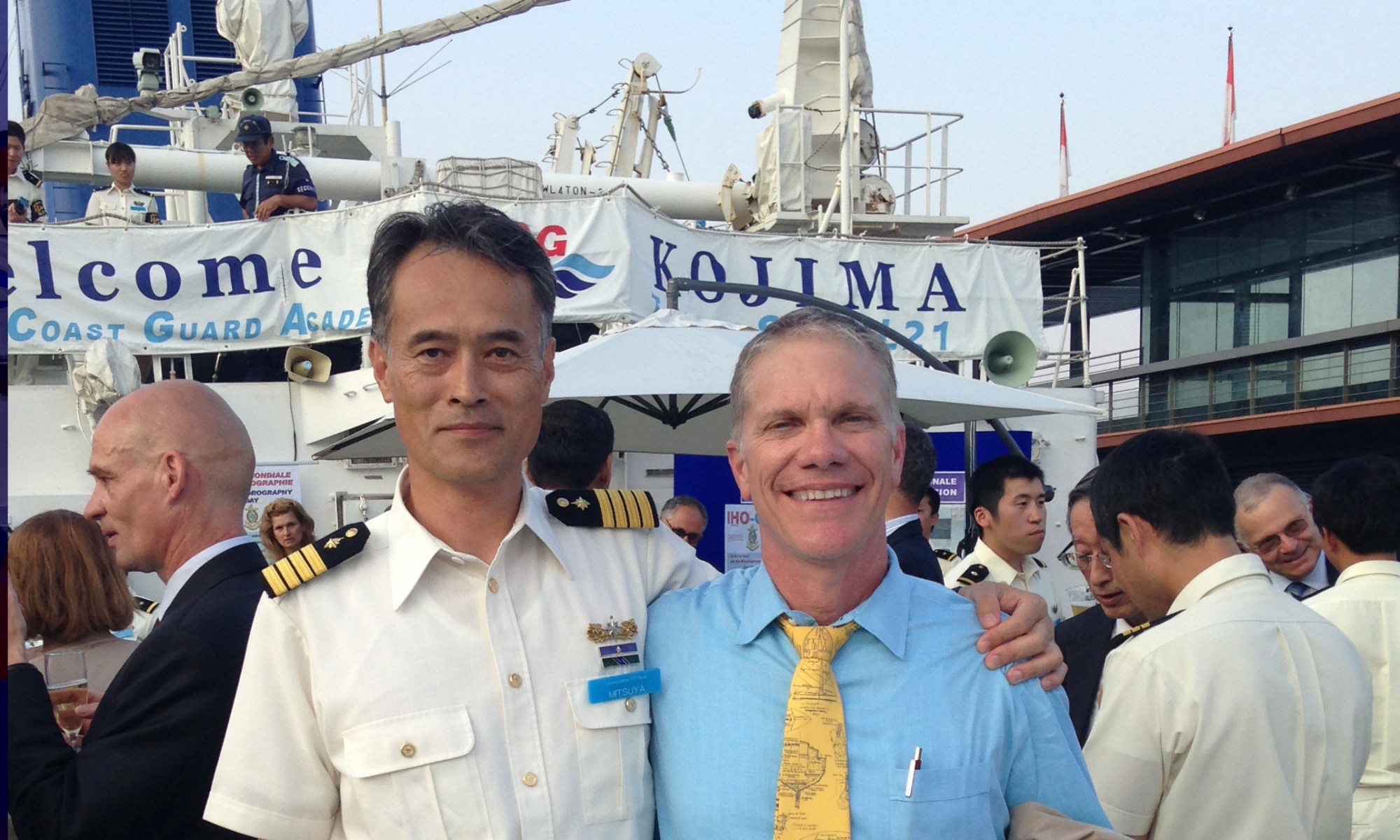 Coast Survey's Tom Loeper and Captain Tetsushi Mitsuya, commanding officer of the training ship Kojima of Japan Coast Guard, attend the IHO event onboard the Kojima.