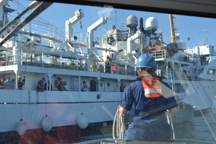 ENS Michelle Levano helps guide a launch back to NOAA Ship Rainier during a hydrographic surveying project in Channel Islands National Marine Sanctuary, California.
