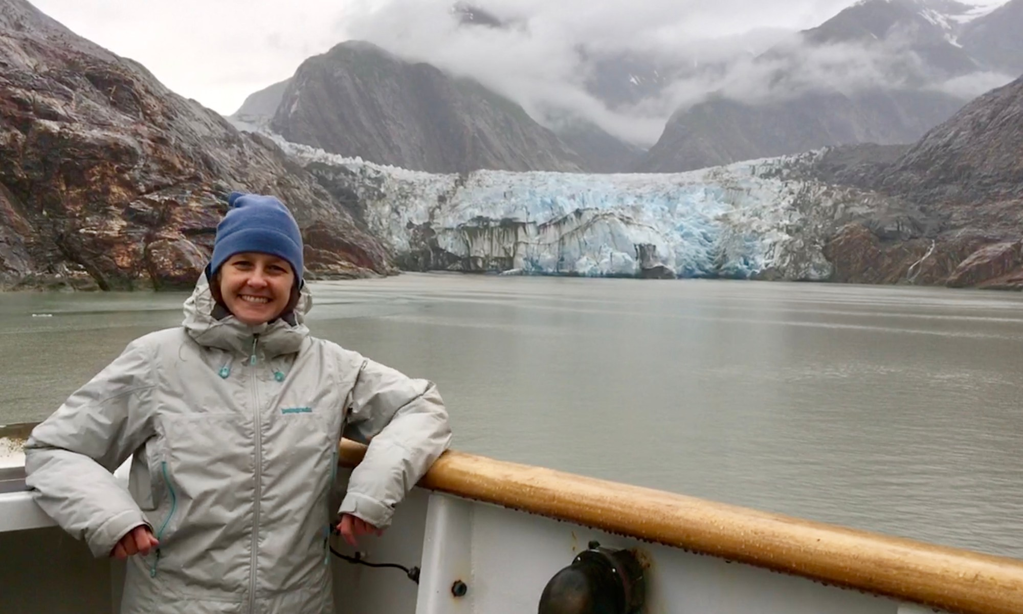 "Martha Herzog enjoying the view of Sawyer Glacier in Tracy Arm, Alaska while aboard the ""NOAA Ship Rainier."""
