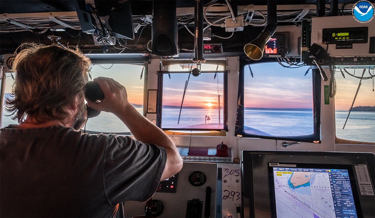 A lookout on NOAA Ship Fairweather observes the waters of Puget Sound, Washington.