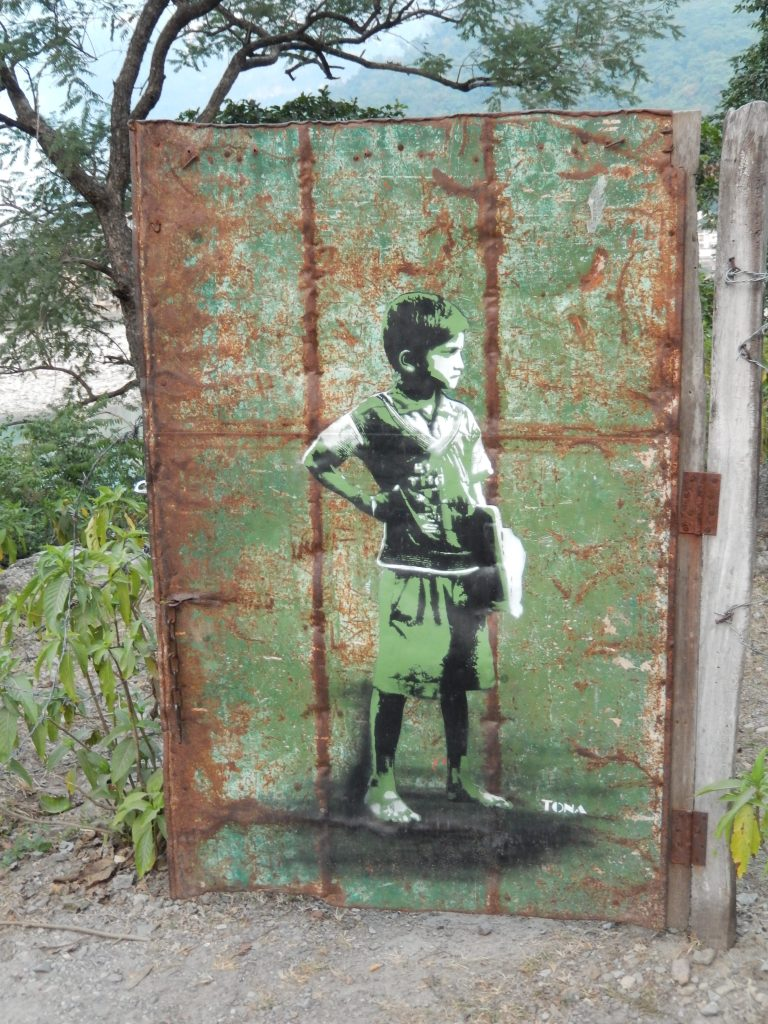 graffiti of young boy in green
