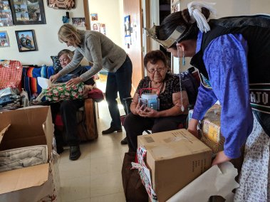 Navajo pageant queen delivering gifts to elder