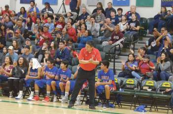 Navajo Times | Donovan Quintero Red Mesa boys head coach Hank Charleston celebrates a shot that counts for two points Saturday during the Arizona 1A boys state quarterfinals against the Joseph City Wildcats at Yavapai College in Prescott, Arizona.