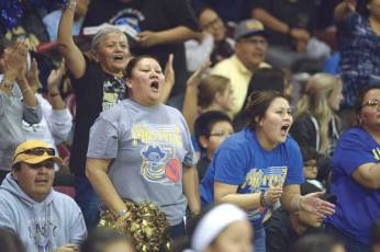 Navajo Times | Donovan Quintero Valley Lady Pirates fans cheer on their team from the stands Saturday during the Arizona 2A girls state quarterfinals against the Thatcher Lady Eagles in Prescott Valley, Arizona.