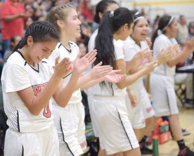 Navajo Times | Donovan Quintero The St. Michael Lady Cardinals begin to celebrate their victory after the final buzzer Saturday in Prescott, Arizona.