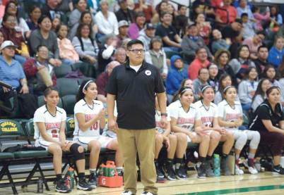 Navajo Times | Donovan Quintero St. Michael Lady Cardinal head coach Carl Adams looks on during the Arizona 1A girls state quarterfinals against the St. David Lady Tigers at the Yavapai College in Prescott, Arizona.