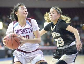 Navajo Times | Donovan Quintero Ganado Lady Hornet Amber James drives the ball for the basket against Chinle Lady Wildcat Grayce Claw (23) during the Arizona 3A girls state quarterfinals at the Prescott Valley Events Center in Prescott Valley, Arizona on Monday evening.