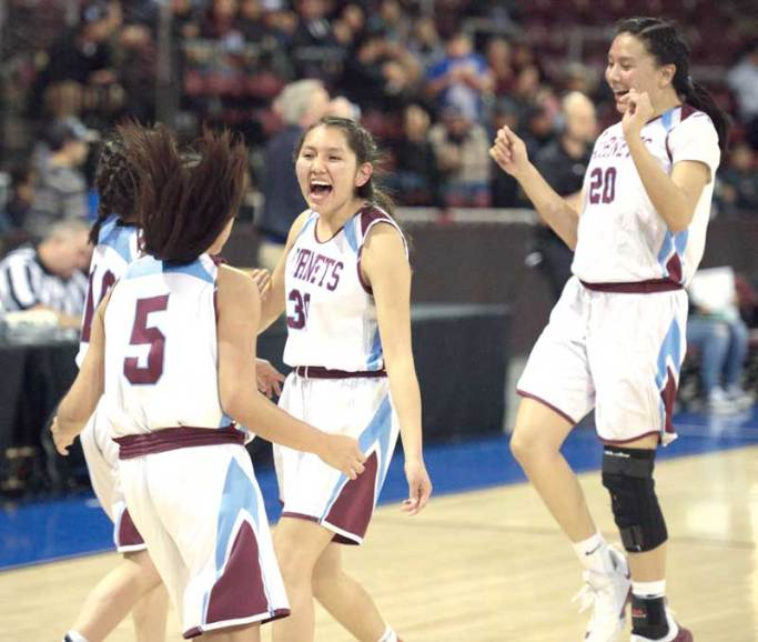 Navajo Times | Donovan Quintero Ganado Lady Hornet Lujuana Louis (30) begins to celebrate with some of her teammates after they defeat the Chinle Lady Wildcats Monday evening at the Prescott Valley Events Center in Prescott Valley, Arizona. Ganado will take on the Monument Valley Lady Mustangs on Friday in the Arizona 3A girls state semifinals game at the Gila River Arena in Glendale, Arizona, at 6 p.m.