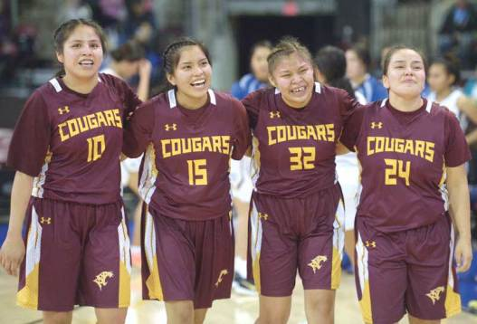 Navajo Times | Donovan Quintero Rock Point Lady Cougars Lara Begay (10), Chrystalana Clark (15), Ranisha Begay (32) and Tamarrah Deswood (24) walk arm-in-arm and celebrate their victory over the Fort Thomas Lady Apaches on Saturday at the Prescott Valley Events Center in Prescott Valley, Arizona.