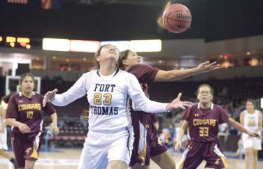 Navajo Times | Donovan Quintero Fort Thomas Lady Apache Vivianna Talgo (23) and Rock Point Lady Cougar Charmaine Leelong go for the loose ball Saturday during the Arizona 1A girls state quarterfinals at the Prescott Valley Events Center in Prescott Valley, Arizona.