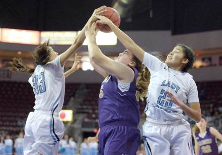 Navajo Times | Donovan Quintero Window Rock Lady Scout teammates Bayle Talkalai (23) and Haley Talkalai (33) overpower a Sabino Lady Sabercat and knock the ball out of her hands Monday in Prescott Valley, Arizona.