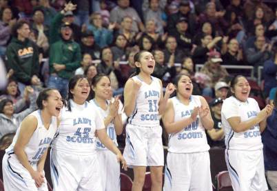 Navajo Times | Donovan Quintero Window Rock Lady Scout Kristen Sanderson (11) and the rest of her teammates cheer on their team from the bench Monday during the Arizona 3A girls state quarterfinals against the Sabino Lady Sabercats.