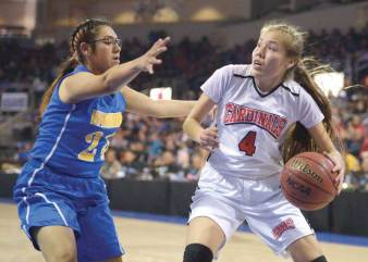 Navajo Times | Donovan Quintero Lady Cardinal Jalynn Smith (4) drives ball at guarding Lady Warrior Esperanza DeCora (24) on Saturday in Glendale, Arizona.