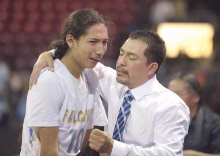 Navajo Times | Donovan Quintero Alchesay Falcons coach Kyle Goklish hugs Harley Upton who becomes emotional after losing to the Rancho Solano Prep Mustangs Saturday in Prescott Valley, Ariz.
