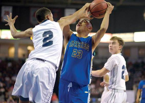Navajo Times | Donovan Quintero Fort Thomas Apache Kobe Talgo has his ball touched by a Gregory School defender on Friday during the Arizona 1A boys championship game at the Prescott Valley Events Center in Prescott Valley, Ariz.