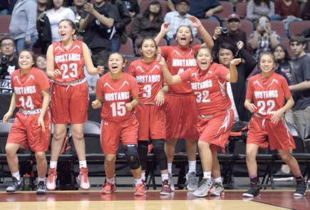 Navajo Times | Donovan Quintero The Ganado Lady Hornets celebrate two points during the Arizona 3A girls' semifinal against the Monument Valley Lady Mustangs at the Gila River Arena in Glendale, Ariz. MV won, 38-32.
