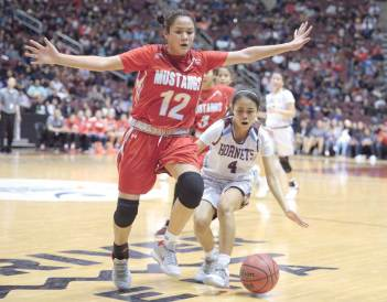 Navajo Times | Donovan Quintero Ganado's Deana Curley (4) and Mustang Lakeshia Begay (12) watch the ball go out of bounds Friday at the Gila River Arena.