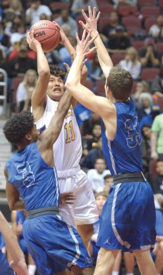 Navajo Times | Donovan Quintero Blue Ridge Yellow Jacket Corey Endfield (11) sets up a shot as Valley Christian Trojan defenders attempt to block him Saturday during the Arizona 3A boys semifinals at the Gila River Arena in Glendale, Ariz.