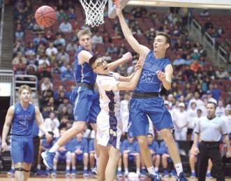 Navajo Times | Donovan Quintero Blue Ridge Yellow Jacket PJ Velasquez, white jersey, has the ball blocked by Valley Christian Trojan defenders Saturday in Glendale, Ariz.