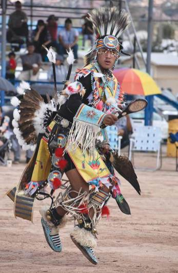 Navajo Times | Rima Krisst Headman Trevor Brimhall performs the chicken dance.