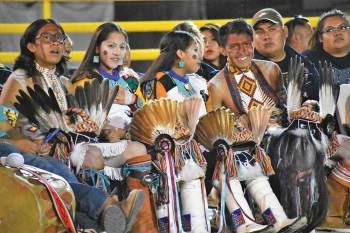 Navajo Times | Rima Krisst Second Mesa, Ariz., Hopi dancers enjoy the night performances at the Cultural Showcase at the Navajo Nation Fair on Sept. 8.