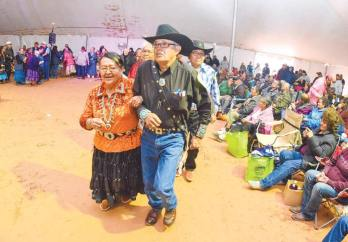 Navajo Times | Krista Allen Nelson Smith and his partner dressed in her traditional outfit lead a round of two-step during the Elder Fest at the 50th annual Western Navajo Fair on Oct. 11.