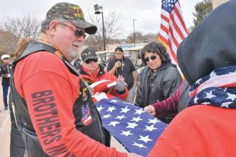 Navajo Times | Rima Krisst The folding of the American flag concludes the Veterans Day ceremonies in Gallup.
