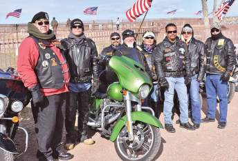 Navajo Times | Rima Krisst Navajo-Hopi Honor Riders and leaders Veterans Helping Veterans and Endless Riders gather at Gallup's Hillcrest Cemetery to honor late and fallen veterans. Left to right are David Cuellar, Mike Withstandley, Orion, Troy (Hammer) Essary, Judy Buffalohead, Thomas Clark, Erika Stevens and Frank Chiapetti.