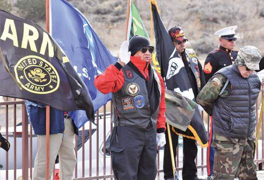 Navajo Times | Rima Krisst Tooley Brown leads the benediction at the Veterans Observance Ceremony at Hillcrest Cemetery in Gallup.