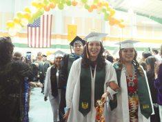 Navajo Times | Paul Natonabah Happy seniors walk in the procession at Wingate High School's graduation on Friday, May 7. Seventy-three seniors graduated.