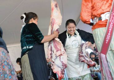 Navajo Times   Ravonelle Yazzie Miss Navajo Nation contestant Shaandiin Parrish, of Kayenta, Ariz., after removing the sheep's backbone during the butchering competition on Monday in Window Rock.