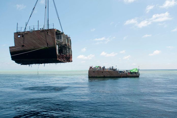 1200px hull section being removed from the former uss guardian - naval post- naval news and information