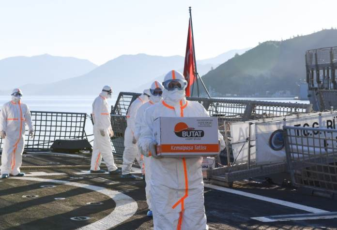 tcg buyukada crew transferring food - naval post- naval news and information