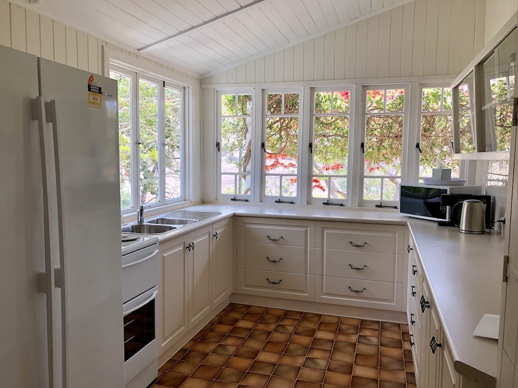 Beaumont kitchen with views of the front porch and flowers