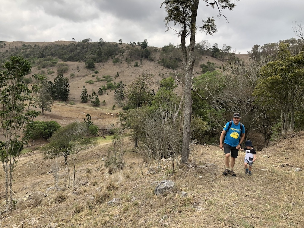 Boy and child hiking at Chinghee mountain with views of surrounding hills
