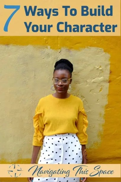 African model poses in a yellow shirt with white skirt polka dots