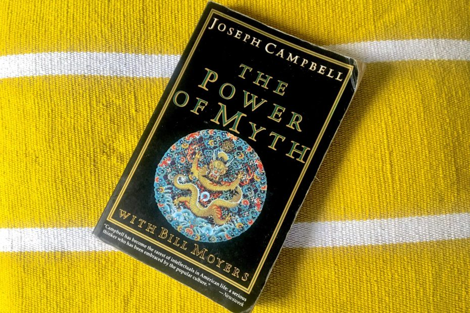 The Power of Myth book by Joseph Campbell with Bill Moyers on a yellow and white textured background.